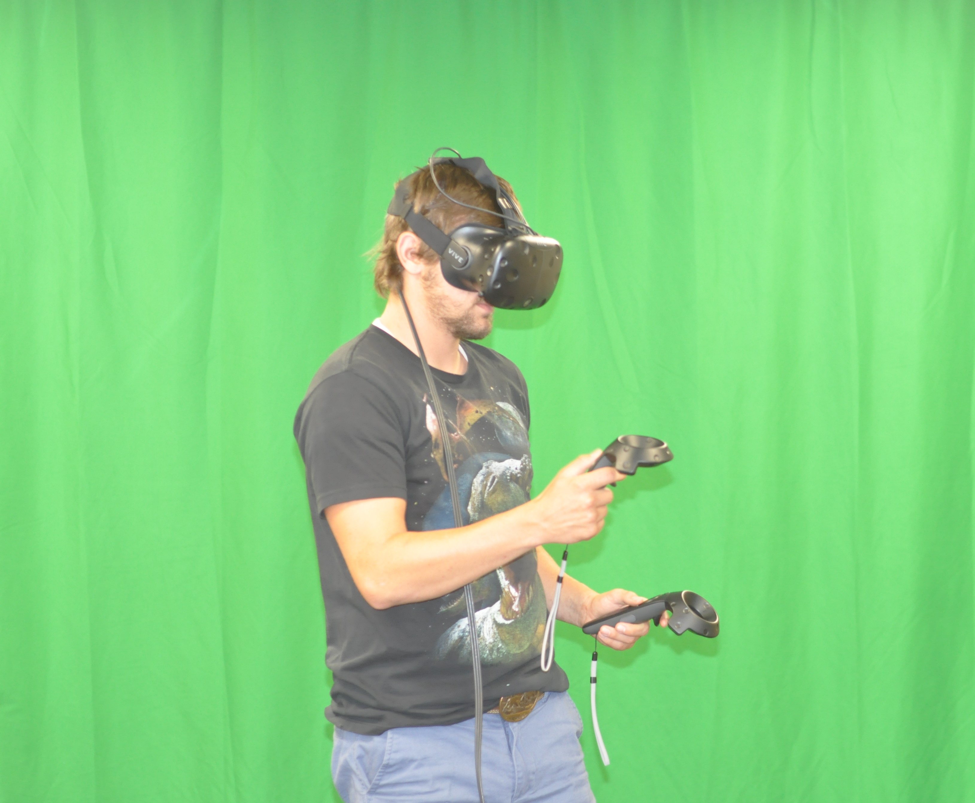 Green screen behind a man in VR